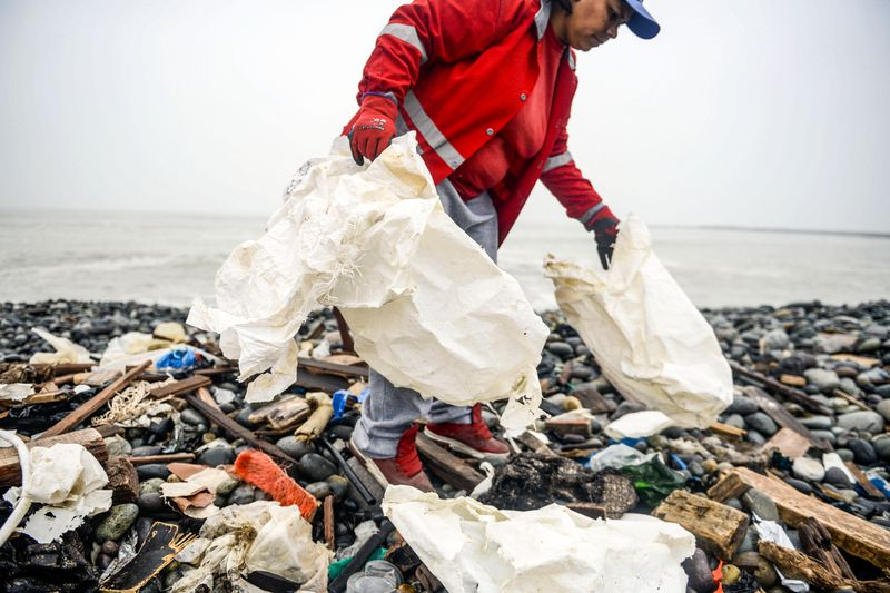 Volunteers clean up plastic waste on a beach in Lima, Peru, during the World Environment Day on June 5, 2018.