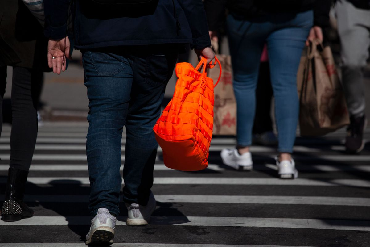 A shopper carries  reusable bag up Seventh Avenue in Chelsea.