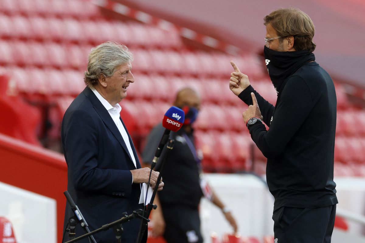 Liverpool's German manager Jurgen Klopp (R) speaks with Crystal Palace's English manager Roy Hodgson (L) before the English Premier League football match between Liverpool and Crystal Palace at Anfield in Liverpool on June 24, 2020