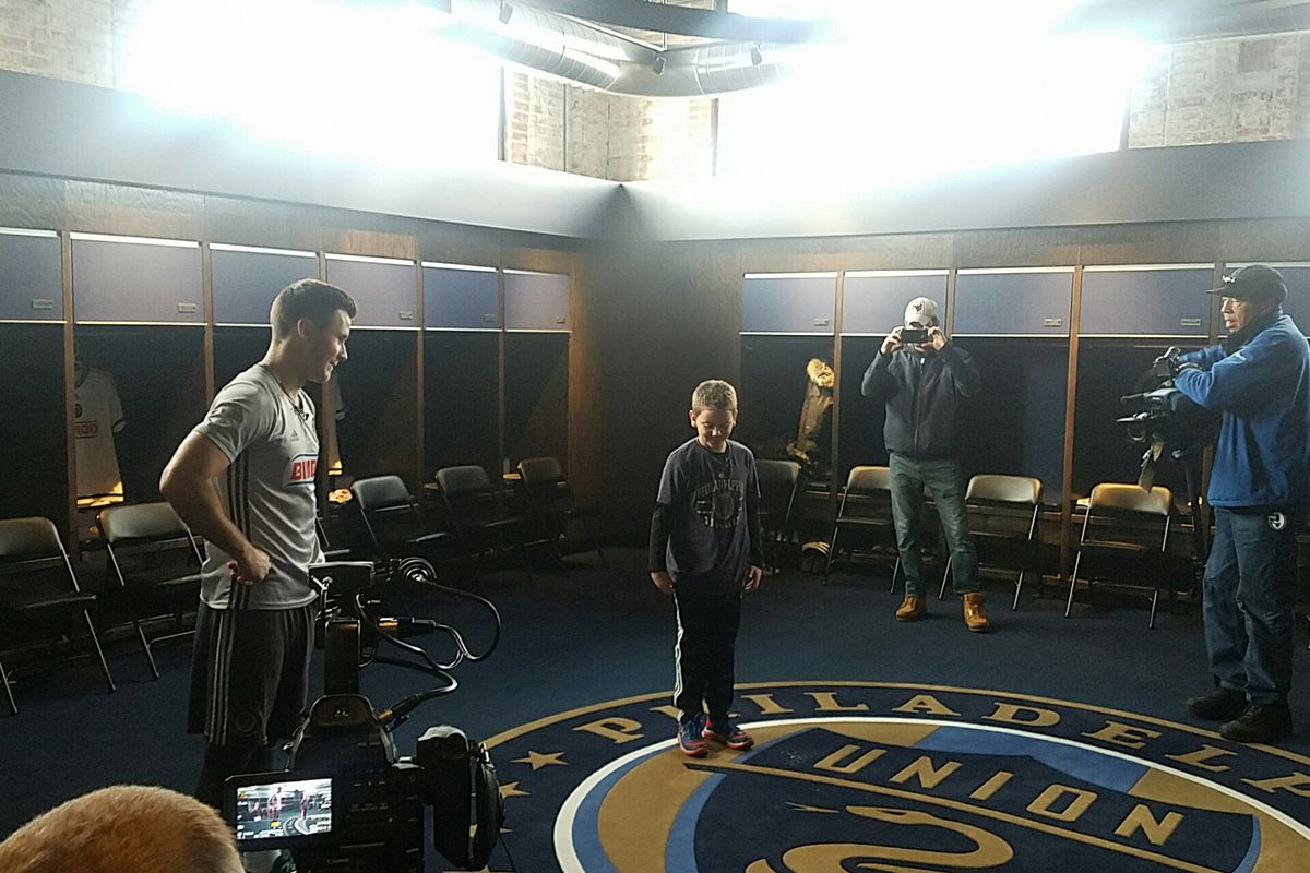 The Philadelphia Union's Keegan Rosenberry and fan Ethan Chambers meet at the Power Training Complex.