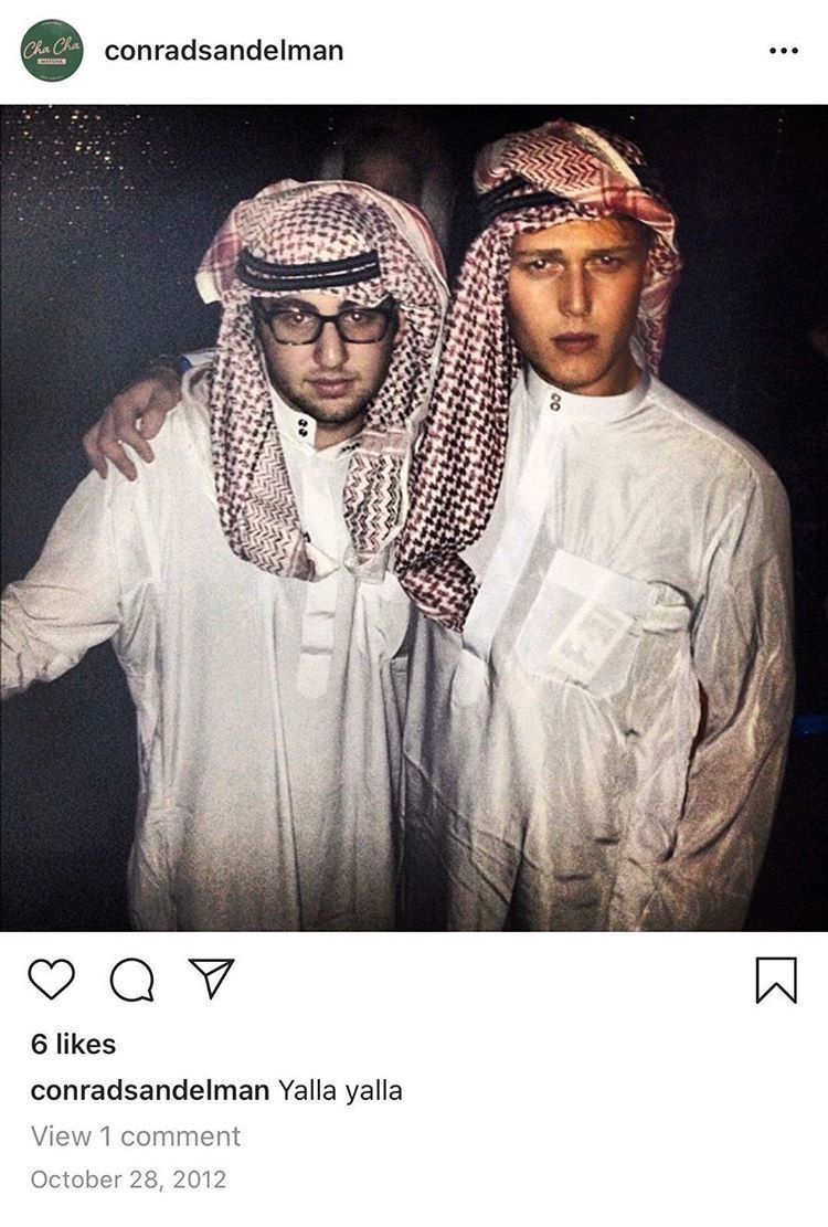 A screenshot of an Instagram post in which two young men pose in while wearing keffiyeh headscarves