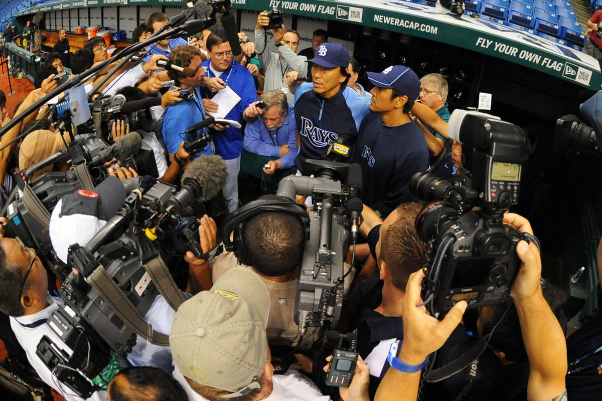 ST. PETERSBURG, FL - MAY 29:  Outfielder Hideki Matsui #35 of the Tampa Bay Rays meets the media before play against the Chicago White Sox May 29, 2012  at Tropicana Field in St. Petersburg, Florida.  (Photo by Al Messerschmidt/Getty Images)
