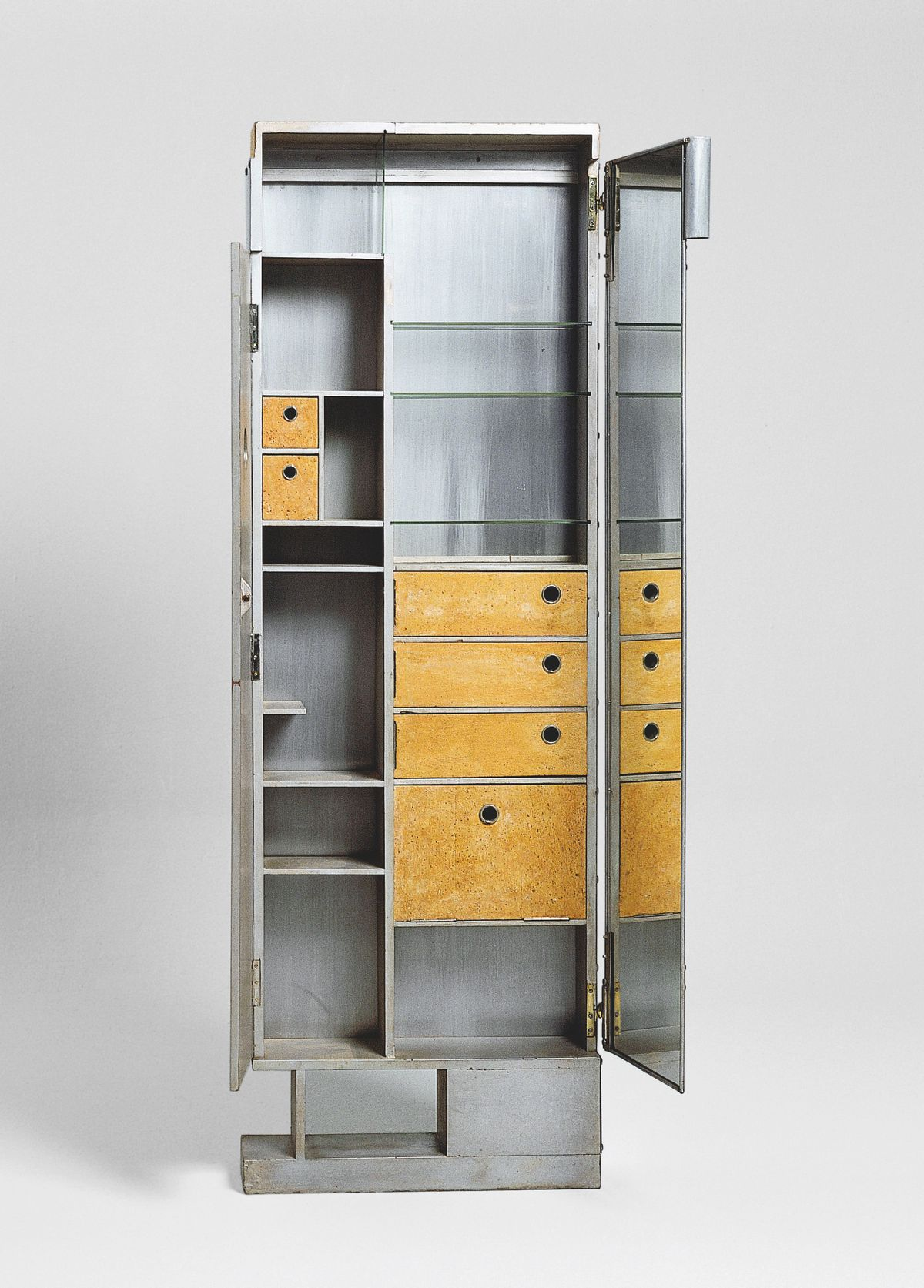 Cabinet made of aluminum sheets and cork panels.