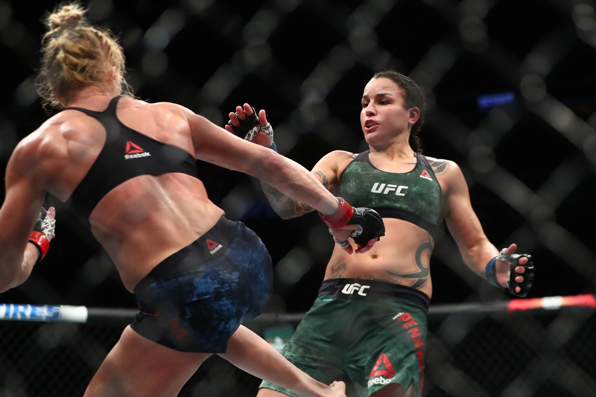 Raquel Pennington defends against Holly Holm during UFC 246 at T-Mobile Arena.