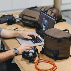 The Prima System modular backpack includes components like the Verge Case, which can be used separately to carry camera gear or other smaller items.