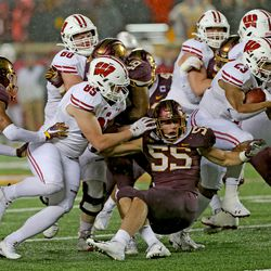 Cormac Sampson (#85) executes a pancake block as Jonathan Taylor (#23) scoots past and into the end zone.