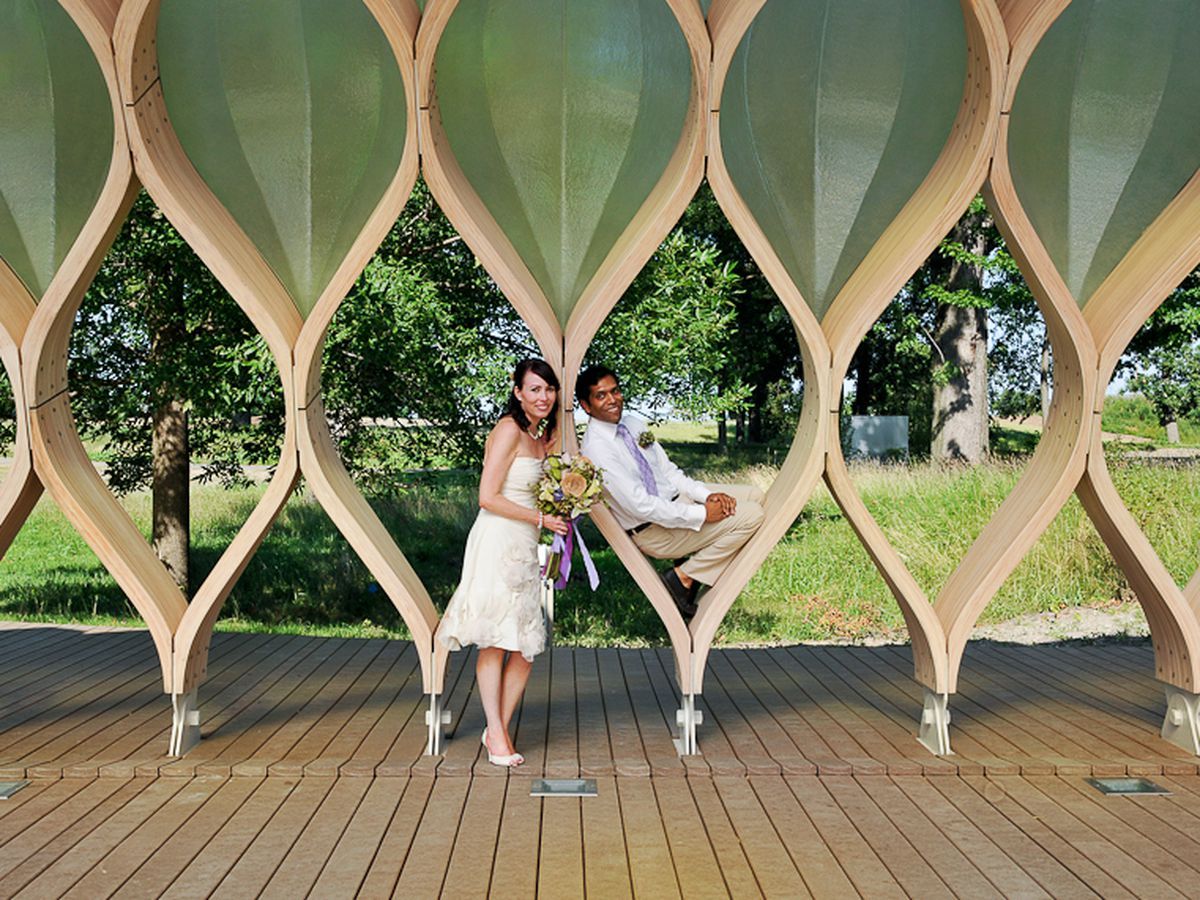"""Michelle and Shaum in the Jeanne Gang pavilion in Lincoln Park Zoo. Photo via <a href=""""http://loveabovephotography.com/blog/?p=278"""">Love Above Photography</a>."""