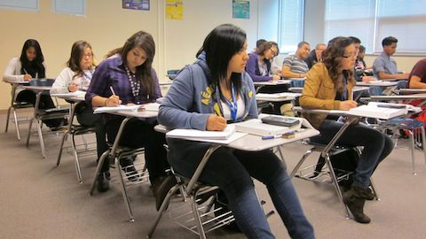 Students work on algebra problems in a college-level course Wednesday at Hinkley High School in Aurora.