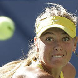 Maria Sharapova eyes the ball during her match against Sania Mirzaat the U.S. Open Sunday in New York.