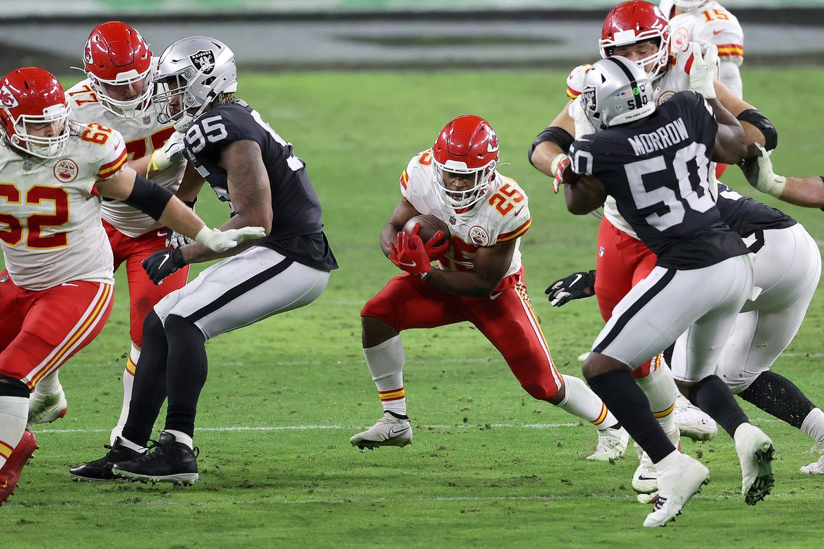 Running back Clyde Edwards-Helaire #25 of the Kansas City Chiefs rushes for short yardage as defensive end Datone Jones #95 and linebacker Nicholas Morrow #50 of the Las Vegas Raiders defend during the second half of an NFL game at Allegiant Stadium on November 22, 2020 in Las Vegas, Nevada.