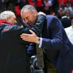 Utah Utes head coach Larry Krystkowiak, right, talks to John M. Huntsman, Sr. after the game against the Prairie View A&M Panthers at the Huntsman Center in Salt Lake City on Friday, Nov. 10, 2017.