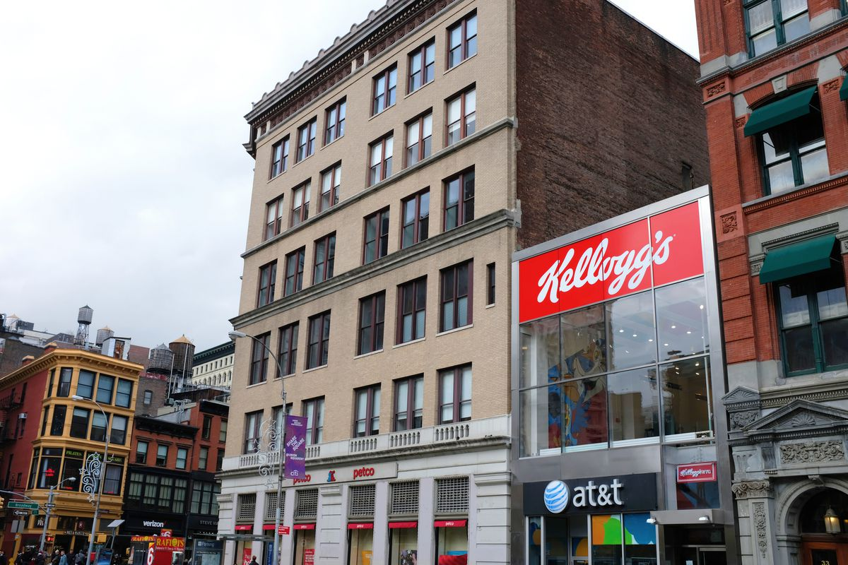 Exterior photo showing a two-story building with a glass facade fronting on Union Square.
