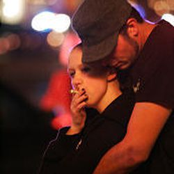 A couple who had been at the mall at the time of the shooting stand outside Trolley Square Monday night.