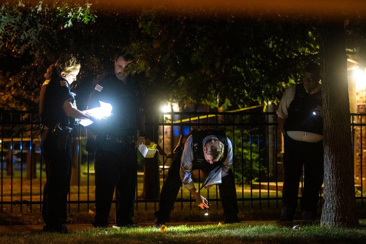 Chicago police investigate the scene where three people were shot.