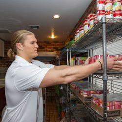 Clay Matthews Stacks Chunky Soup Inside Food Bank