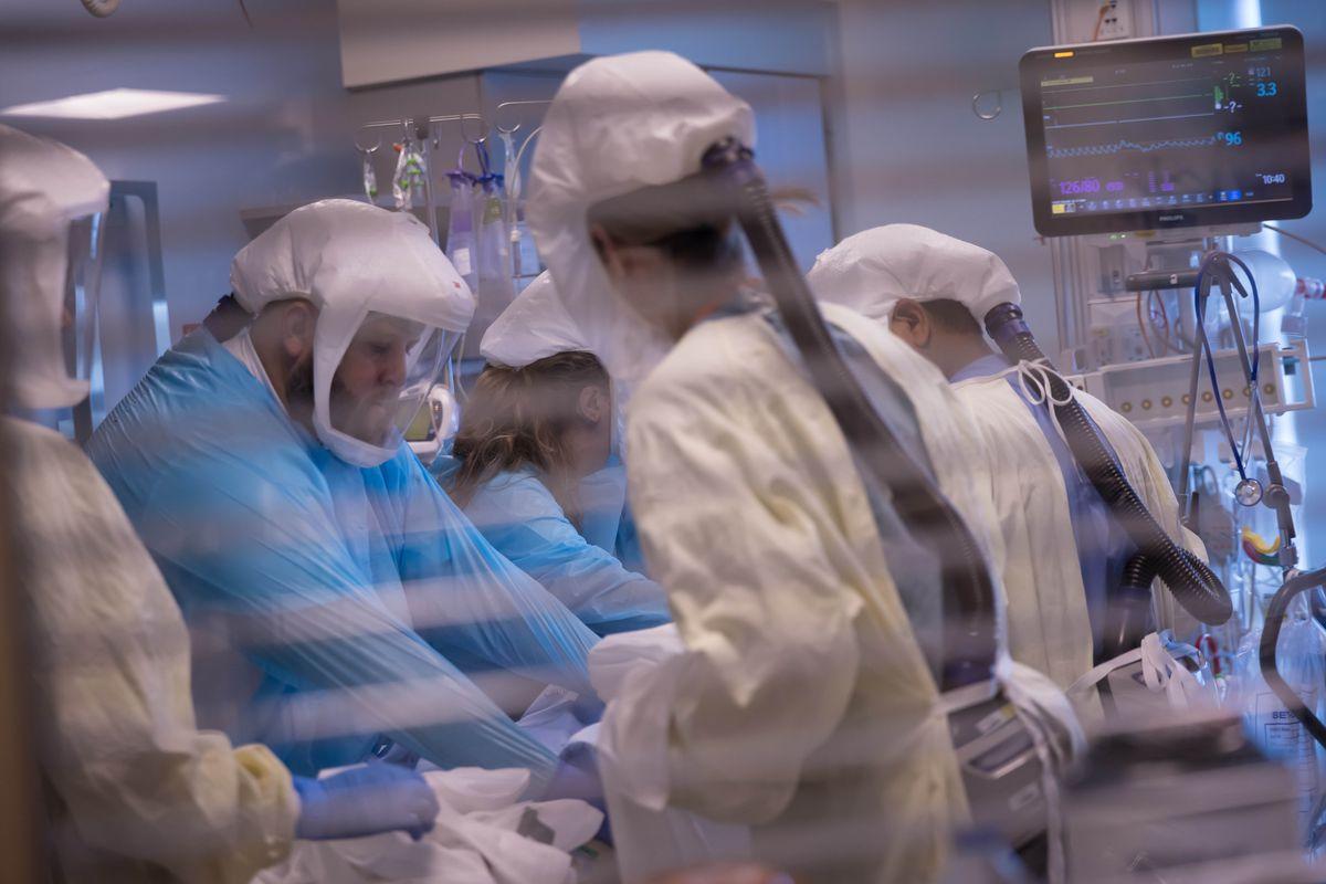University of Utah Health workers treat patients inside the medical intensive care unit at University of Utah Hospital.