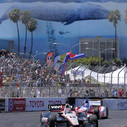 Will Power, of Australia, races in front of James Jakes, of England, with the Long Beach convention center in the background, during the Indy Car Series' Grand Prix of Long Beach auto race, Sunday, April 15, 2012, in Long Beach, Calif. Power won the race.