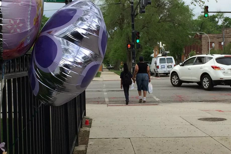 Balloons adorn fence outside Providence Englewood Charter School in May 2016 after Samyra Lee was struck and killed while trying to cross Ashland Avenue near the school.