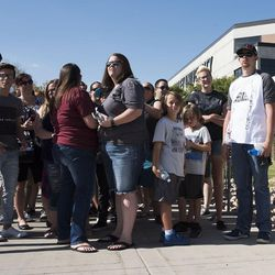 """Lauren Butler, of Provo, and her brother, Sean Elliot, of Orem, wait at the front of the line for the LoveLoud Festival at Utah Valley University in Orem on Saturday, Aug. 26, 2017.  The two got in line for the sold out festival at 10 a.m. """"I love it,"""" Butler said. """"Everyone shows love to everyone. That is what it is all about."""""""