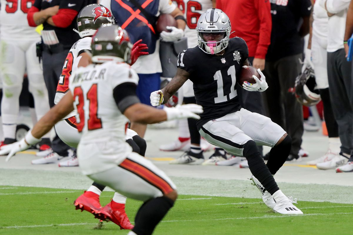 Henry Ruggs III #11 of the Las Vegas Raiders runs with the ball in the first quarter against the Tampa Bay Buccaneers at Allegiant Stadium on October 25, 2020 in Las Vegas, Nevada.