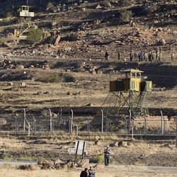 Soldiers search near the site of an explosion at an ammunition store in Afyonkarahisar in western Turkey which killed 25 soldiers and wounded four others, Thursday, Sept. 6, 2012. An explosion and blaze triggered by an accidentally dropped hand grenade has killed 25 soldiers during a stock check at a Turkish ammunition depot, the government said Thursday. Four other soldiers were injured in the blast, which lit up the night sky late Wednesday with flames, and shattered windows in homes in the nearby town of Afyonkarahisar in western Turkey, terrifying residents. (AP Photo)