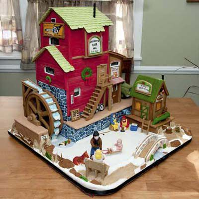 Gingerbread flower with a home and an outdoor covered in snow with people and animals.