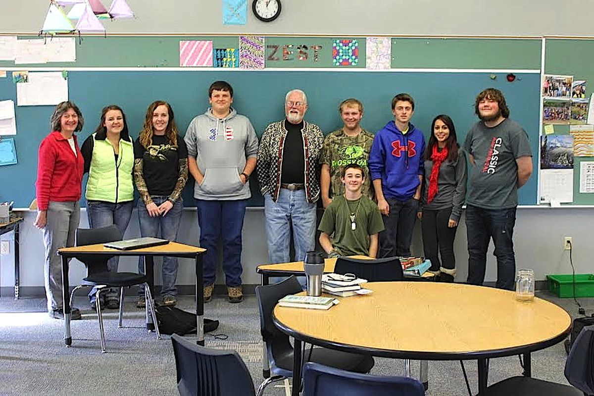 Teacher Denise Perritt (far left) poses with her high school English students and a guest speaker who visited her class, author Robert Fulghum.