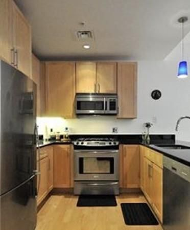 That kitchen, which has a U-shaped counter and an oven at the crux of the U.
