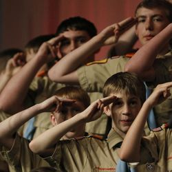 Hundreds of Boy Scouts from the Great Salt Lake Council salute the flag as it is posted at a banquet held in commemoration of the 100th birthday for the Great Salt Lake Council of the Boy Scouts of America at the Salt Palace in Salt Lake City, Utah on Thursday, Feb., 25, 2010.  Mike Terry, Deseret News