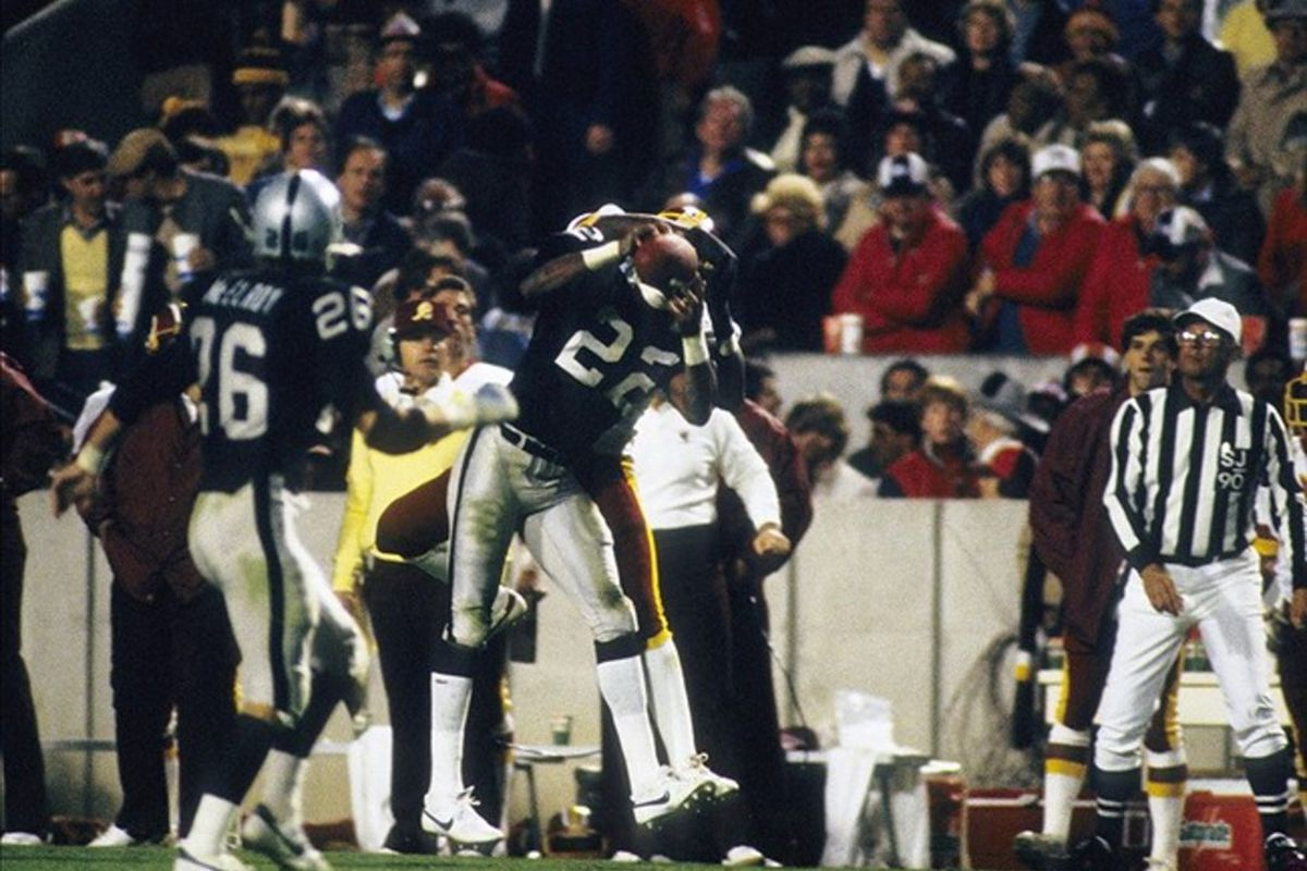The great Mike Haynes intercepting a pass during Super Bowl XVIII, propelling the Raiders to victory. (Richard Mackson-US PRESSWIRE)