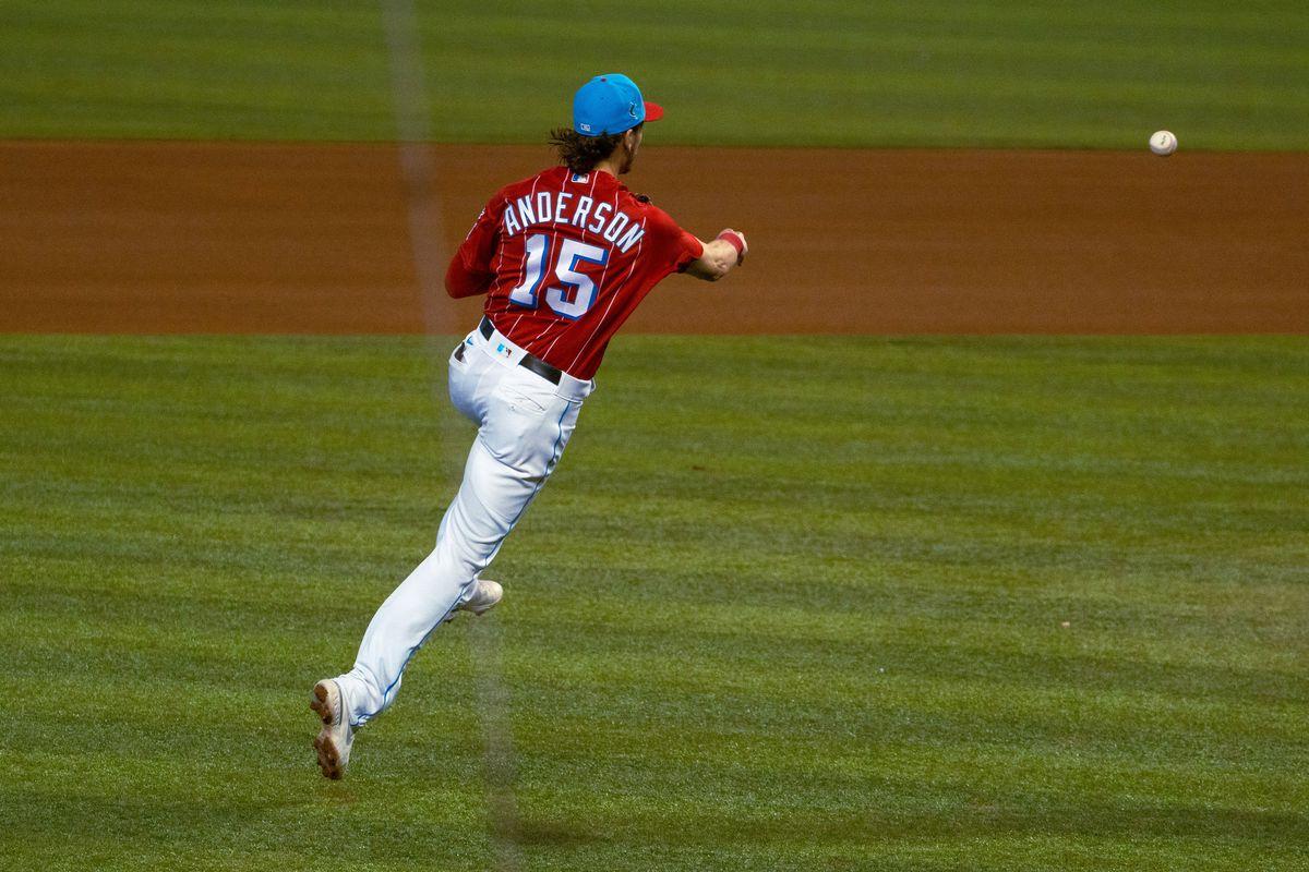 Marlins third baseman Brian Anderson throws across the diamond