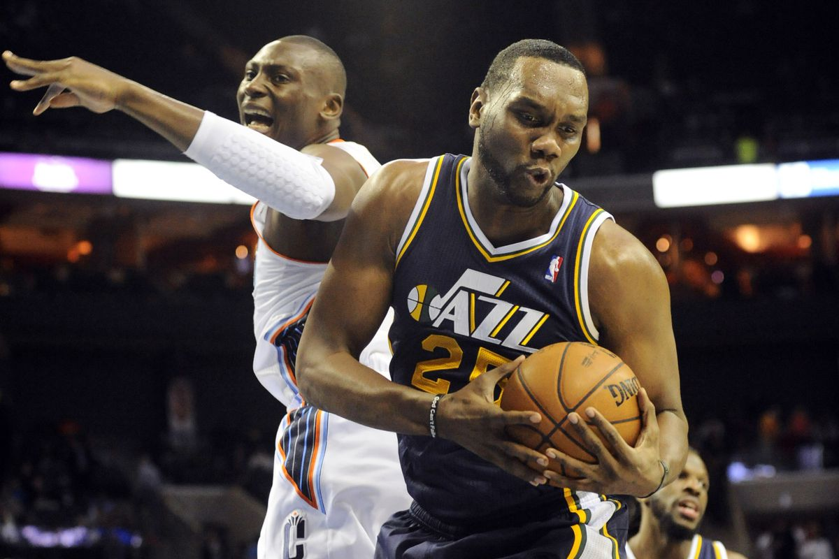 Al Jefferson and Bismack Biyombo making funny faces.