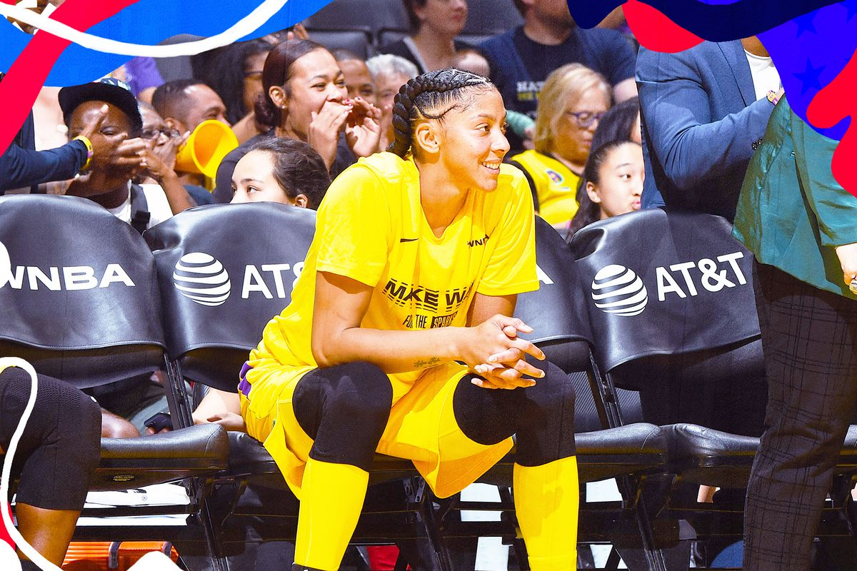 Candace Parker sits on the bench for the Los Angeles Sparks.