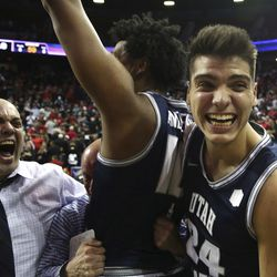 Utah State coach Craig Smith, left, celebrates with players following victory against San Diego State in the Mountain West Conference championship game Saturday, March 7, 2020, in Las Vegas. Smith was named head coach of the Runnin' Utes on March 27, 2021, replacing Larry Krystkowiak.