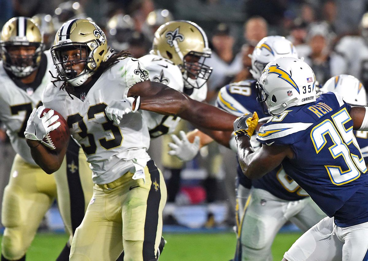 Carson, CA, USA; New Orleans Saints running back Trey Edmunds (33) runs  past Los Angeles Chargers defensive back Ryan Reid (35) in the second  half at StubHub Center.