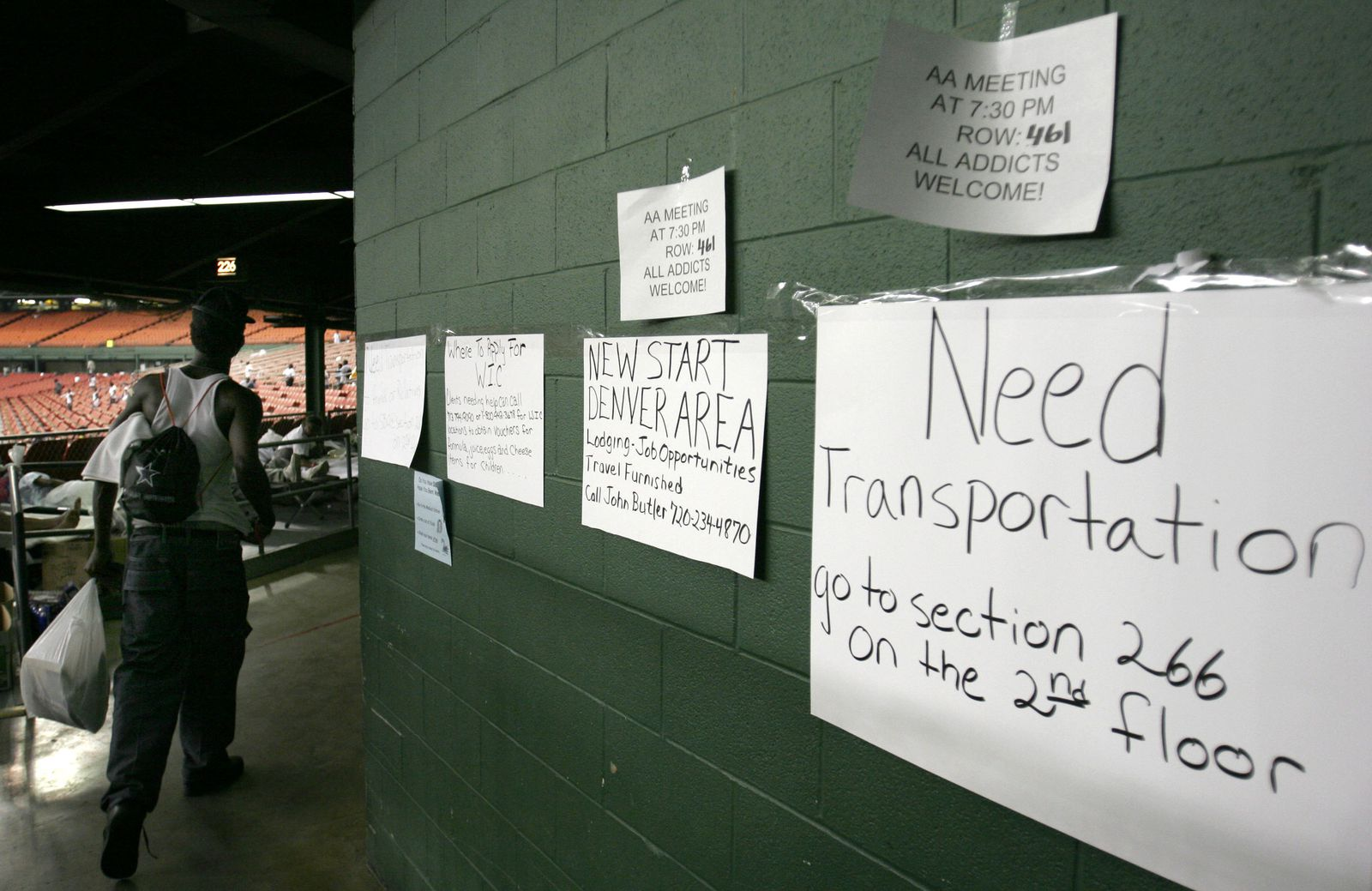 Signs posted at a stadium for events, including an AA meeting.