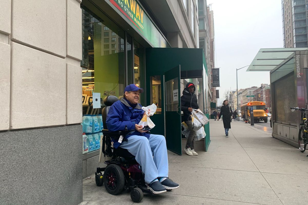 Robert Acevedo, 54, clutches his plastic bag after leaving a Fairway Market on Sixth Avenue and 26th Street in Manhattan.