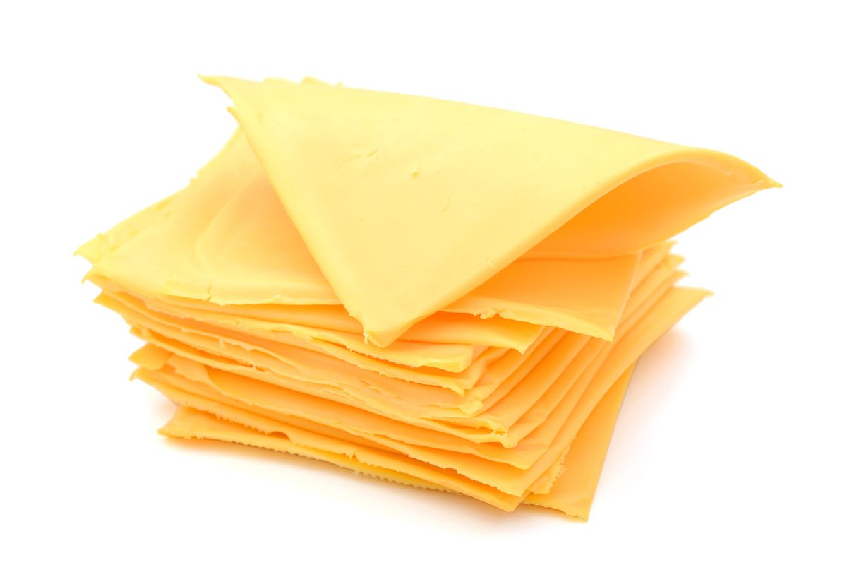 a pile of cheese slices