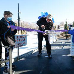 Bountiful Mayor Randy Lewis cuts the ribbon during the grand opening of the new Bountiful Ice Ribbon in Bountiful on Saturday, Dec. 5, 2020.