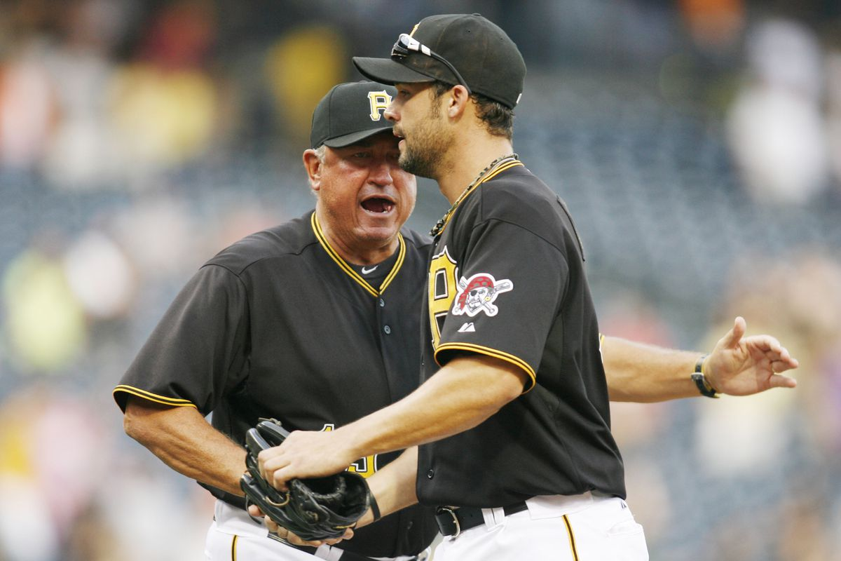 August 16, 2012; Pittsburgh, PA, USA; Pittsburgh Pirates manager Clint Hurdle (rear) congratulates Pirates right fielder Garrett Jones (46) after defeating the Los Angeles Dodgers 10-6 at PNC Park. Mandatory Credit: Charles LeClaire-US PRESSWIRE
