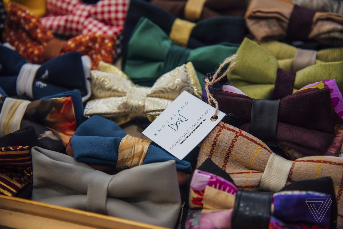 Knotzland bow ties, made from upcycled textile waste, are displayed on a table