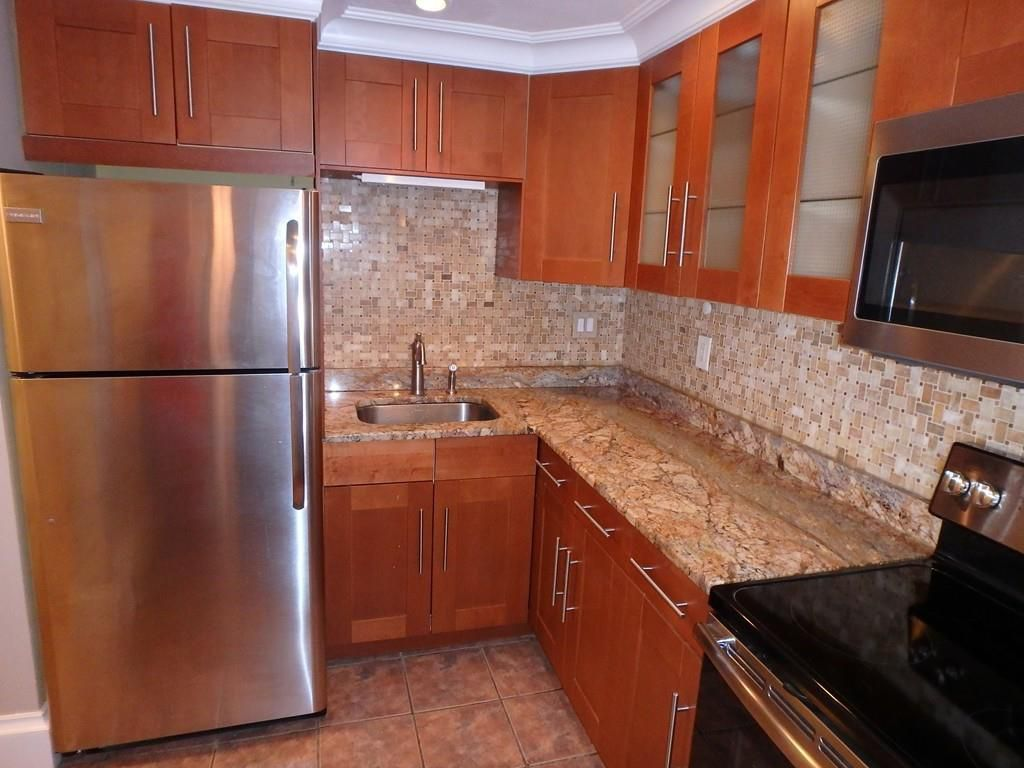 A kitchen with a counter at a right angle.