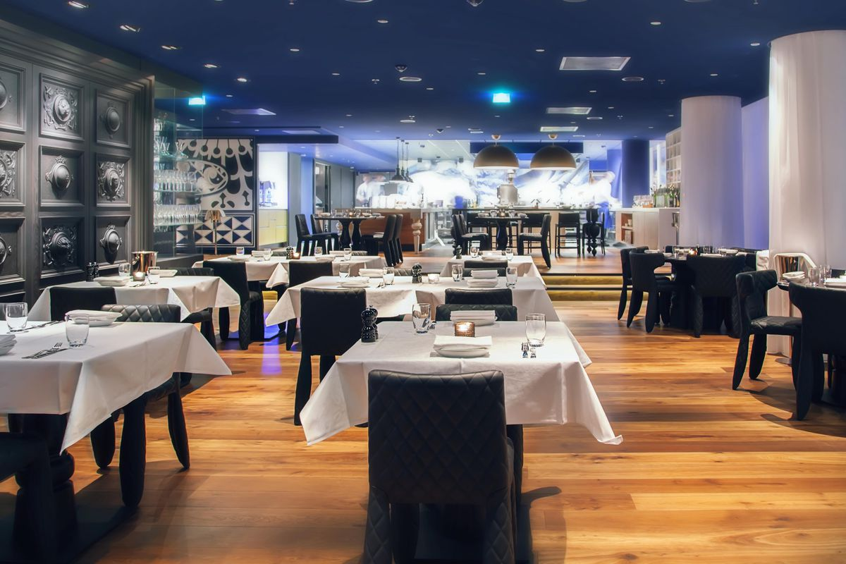 modern restaurant with white tableclothes