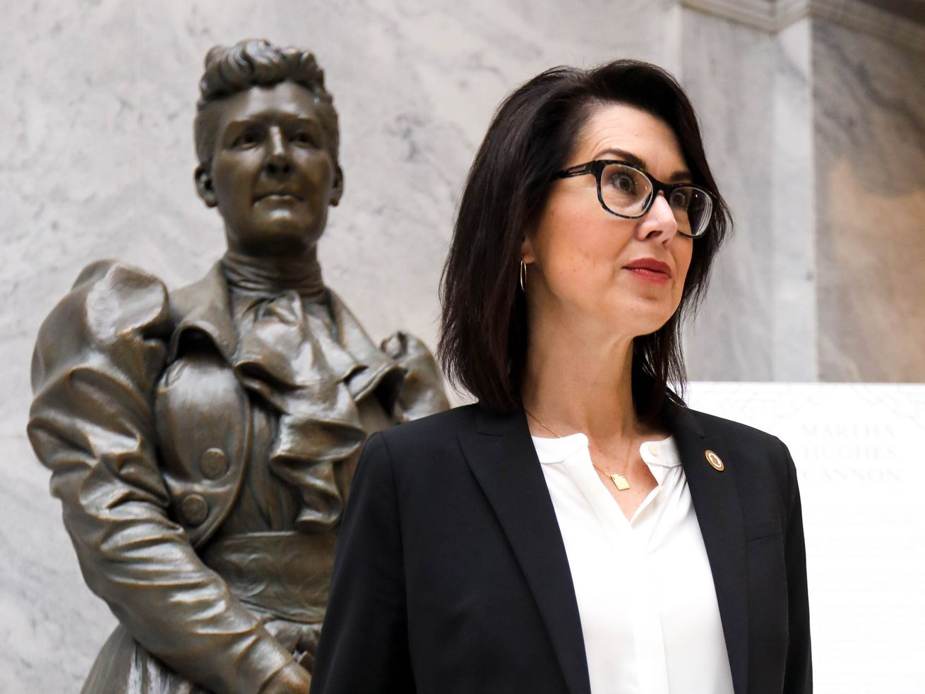 Lt. Gov. Deidre Henderson poses for a photo with a statute of Martha Hughes Cannon at the Capitol in Salt Lake City on Thursday, March 25, 2021.