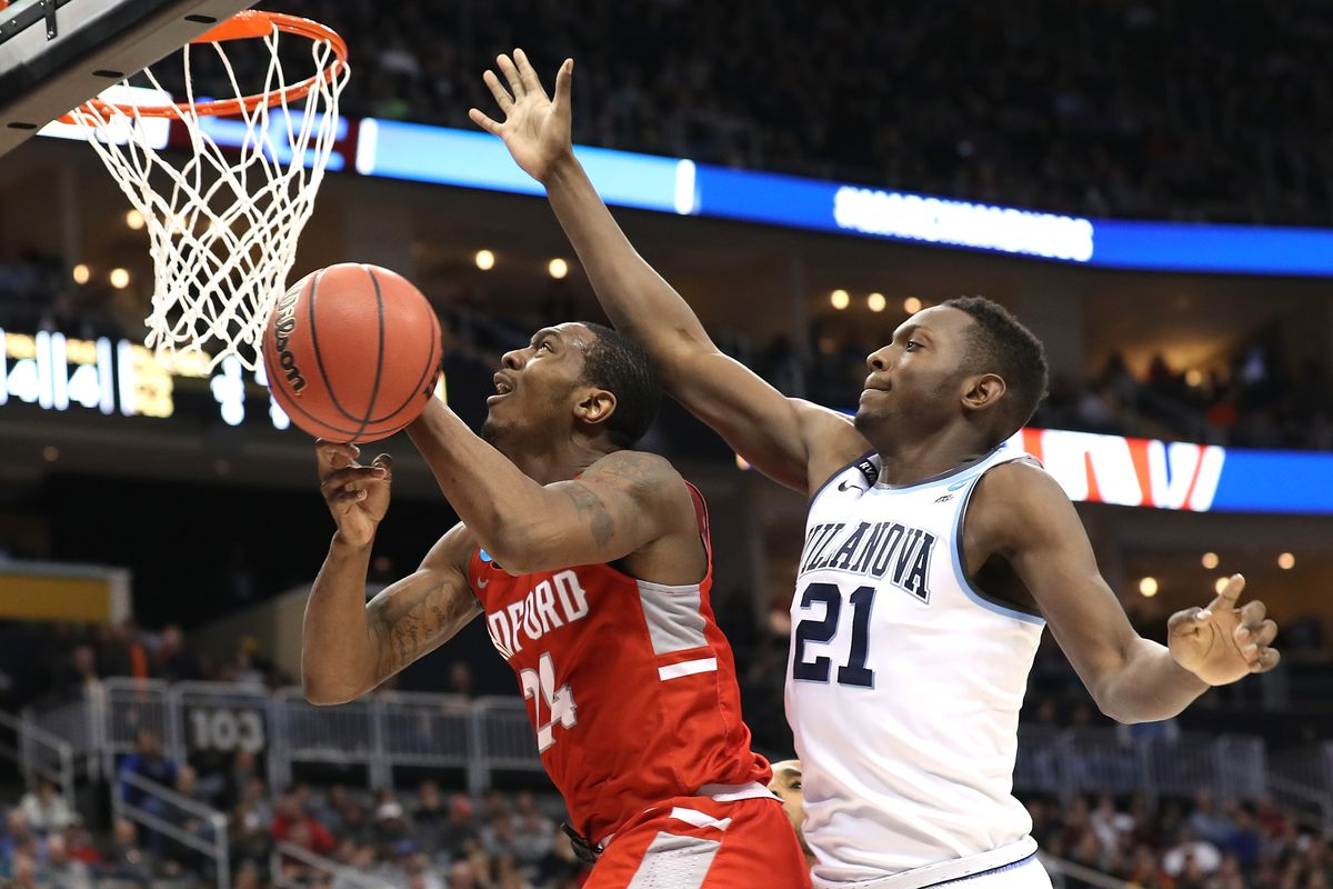 Villanova's Dhamir Cosby-Roundtree defends Radford's Ed Polite Jr. in the first round of the 2018 NCAA Men's Basketball Tournament