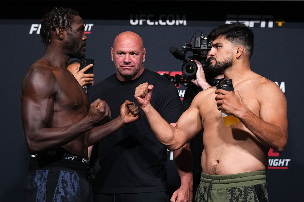 In this UFC handout, (L-R) Opponents Jared Cannonier and Kelvin Gastelum face off during the UFC Fight Night weigh-in at UFC APEX on August 20, 2021 in Las Vegas, Nevada.
