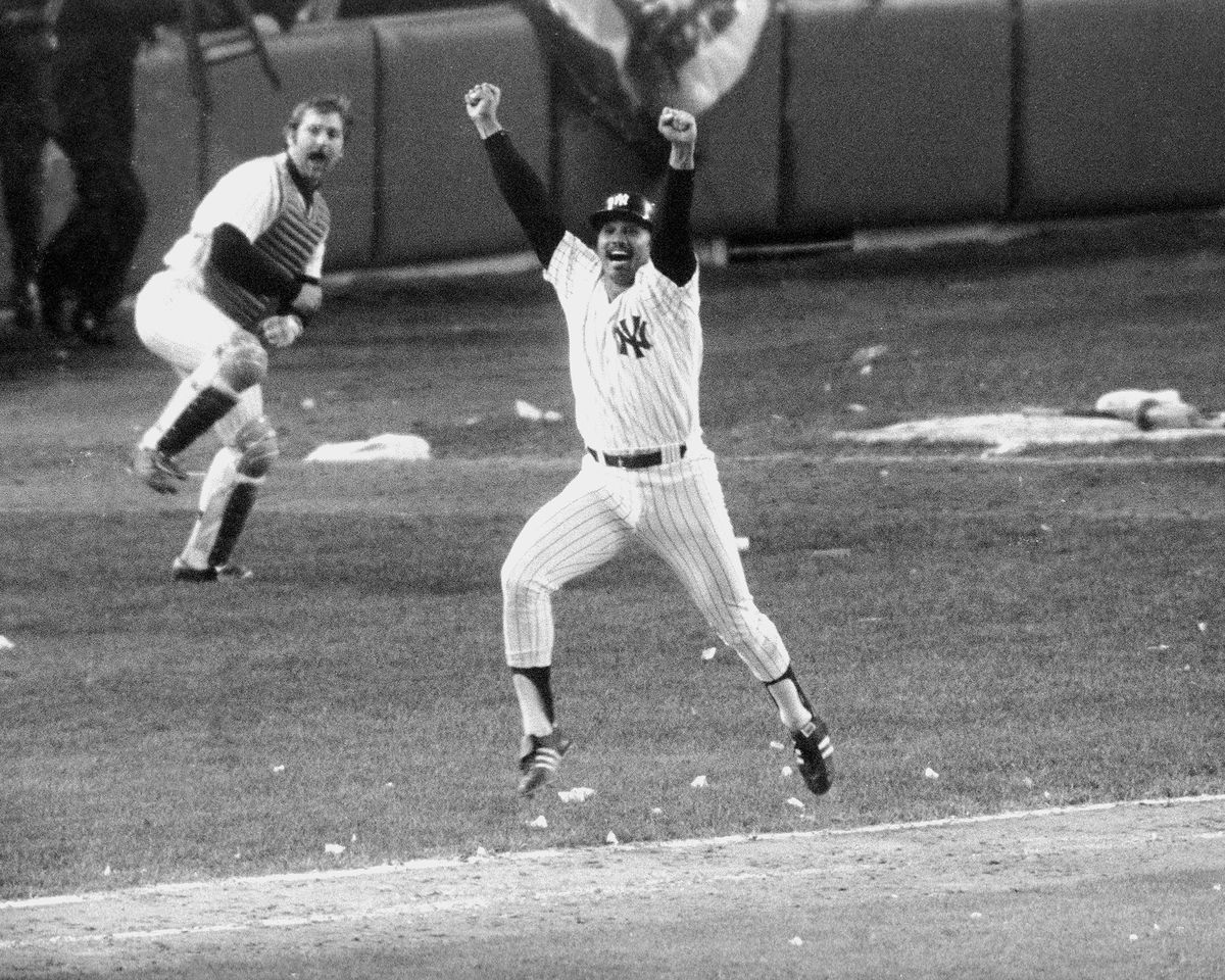 New York Yankees' Chris Chambliss jumps for joy after connec