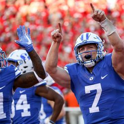 Brigham Young Cougars quarterback Taysom Hill (7) celebrates after running the ball in for a touchdown, putting BYU up 13-7 after the PAT, during a game against Utah at Rice-Eccles Stadium in Salt Lake City on Saturday, Sept. 10, 2016.