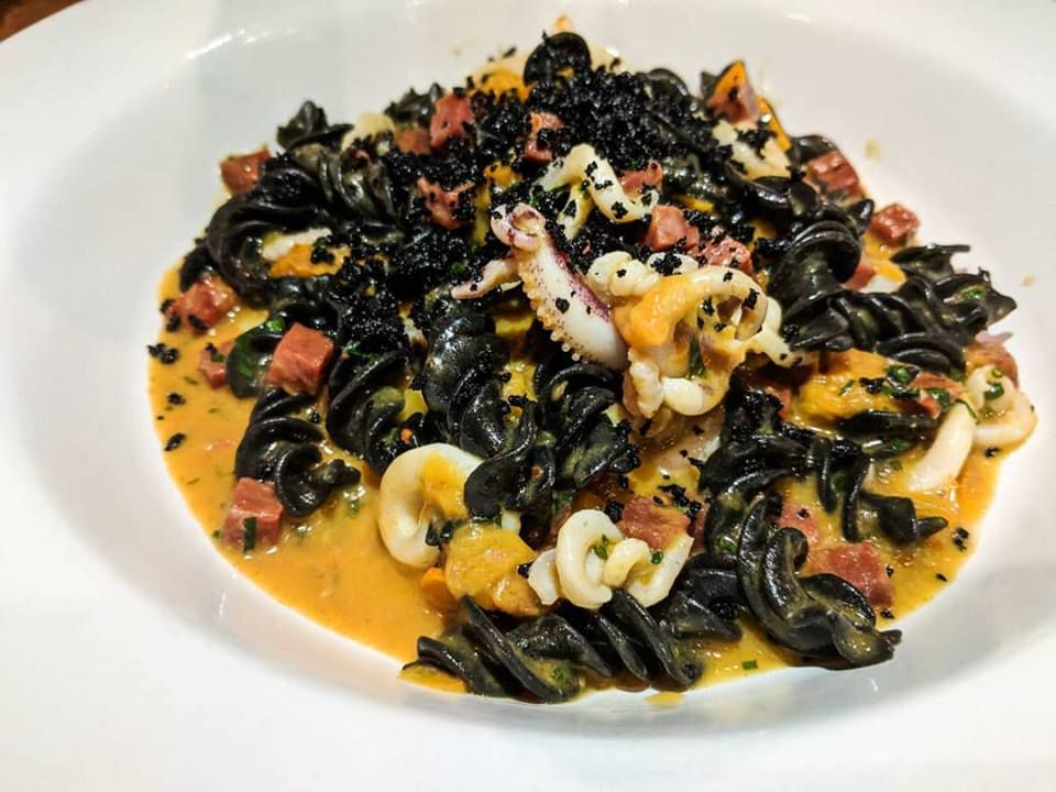 Squid ink fusilli with sopressata, tomato, and ink and olive breadcrumbs at Chickadee