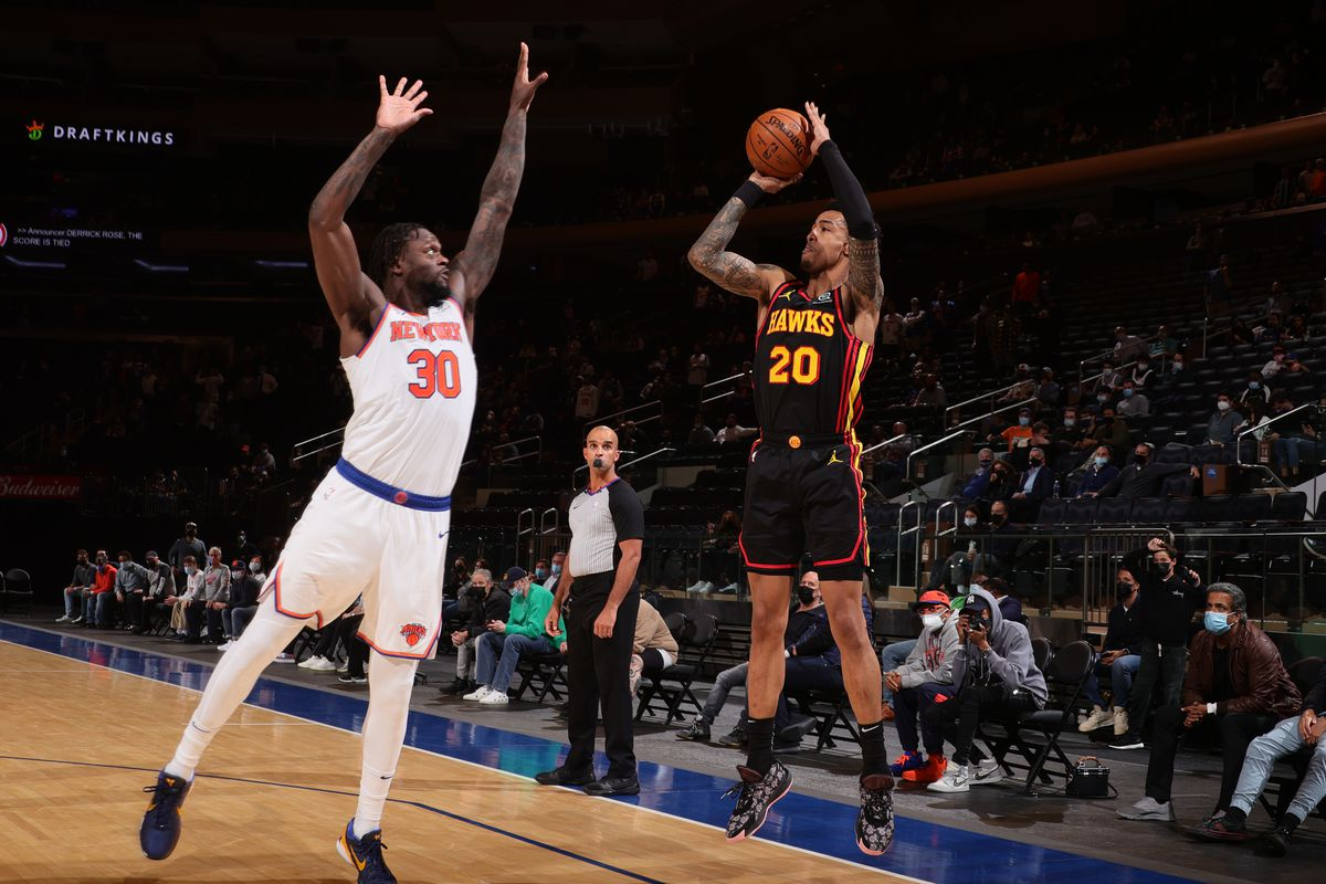 John Collins of the Atlanta Hawks shoots the ball during the game against the New York Knicks on April 21, 2021 at Madison Square Garden in New York City, New York.